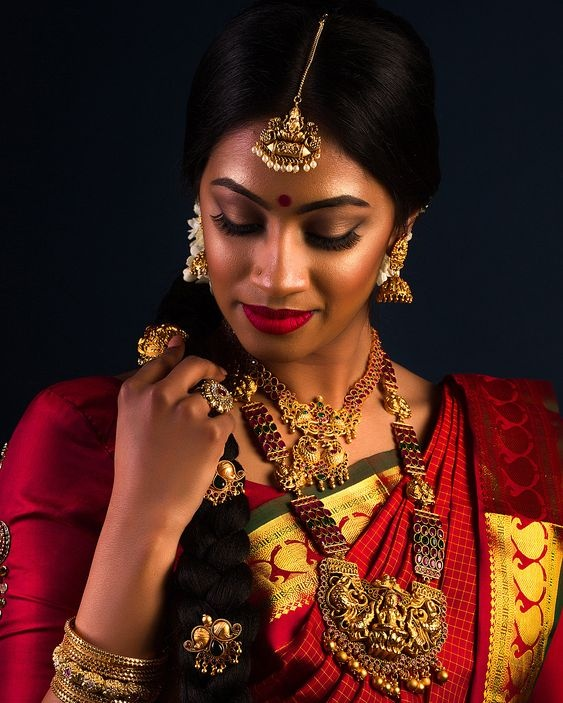 If you have a dusky complexion and want to emphasize your lips more than your eyes, then this Indian bridal makeup look is something you can take ...