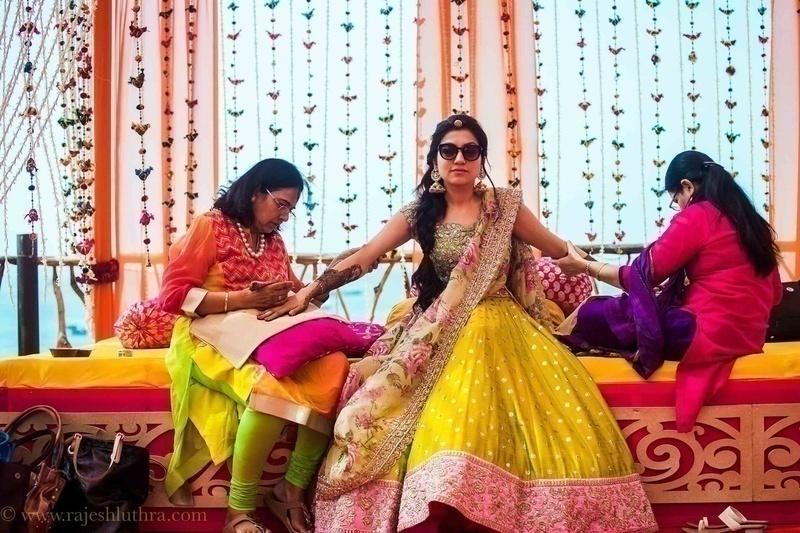 Mehndi Dupatta Decoration : Destination wedding held at vivanta by taj goa with a vibrant