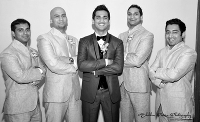 Groomsmen handsomely dressed textured high necked suits