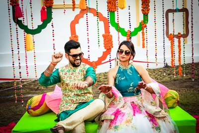 The bride and groom enjoy at their carnival themed mehendi ceremony!