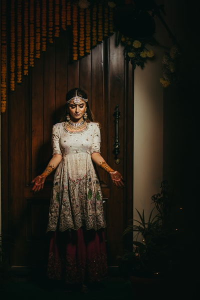 The bride flaunting her beautiful mehendi ceremony in a dim lit photography