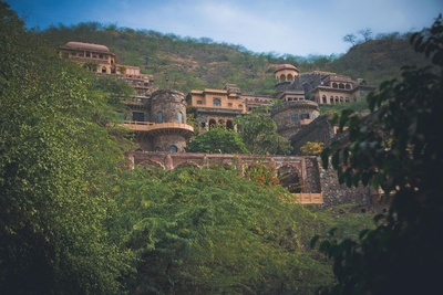 Resting between a bed of mountains and lush green forests, the Neemrana Fort Palace
