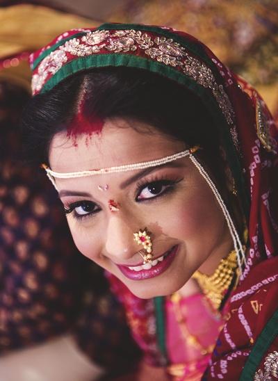Mundavalya and studded Nathni are essential jewels in Maharashtrian weddings
