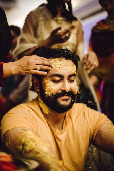 The dulha seems to be enjoying his haldi ceremony