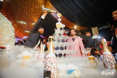 Champagne celebrations during the wedding reception of Manjot and Sandeep