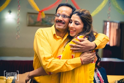 Bride with her father at her haldi