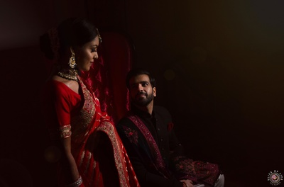 the couple posing at their reception. Total royal vibes