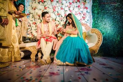 engagement ceremony couple shot in blue lehenga and pink sherwani