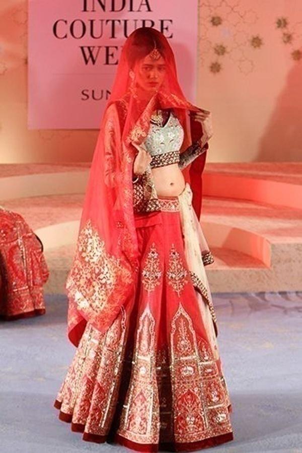 Classic red bridal lehenga for wedding by Anju Modi