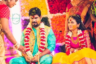 bride and groom in the haldi ceremony as it progresses