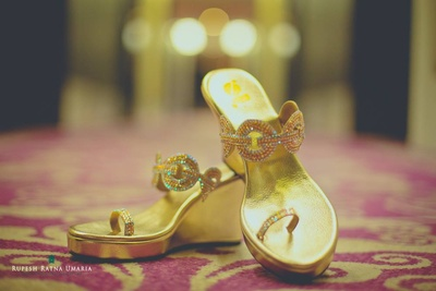 Gold toe sandals studded with stones to be styled with blush pink and aqua lehenga