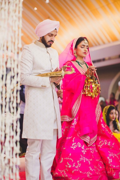 A candid picture of the couple during the Sikh wedding