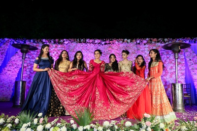 The bridesmaids flaunting the bride's dark pink lehenga with shimmery embellishments!