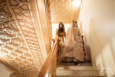 Ain makes her way down the stairs for her Kashmiri Muslim wedding ceremony.