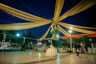 Gold drapes and series lights for wedding decor