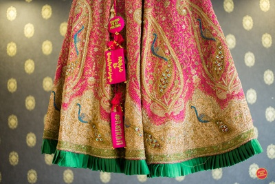 Personalised lehenga with quirky latkans for the bride's wedding ceremony