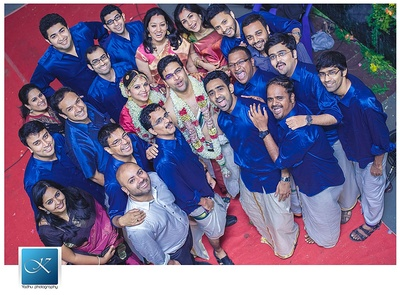 Groomsmen dressed in sapphire blue silk shirts and lungi, swag much?