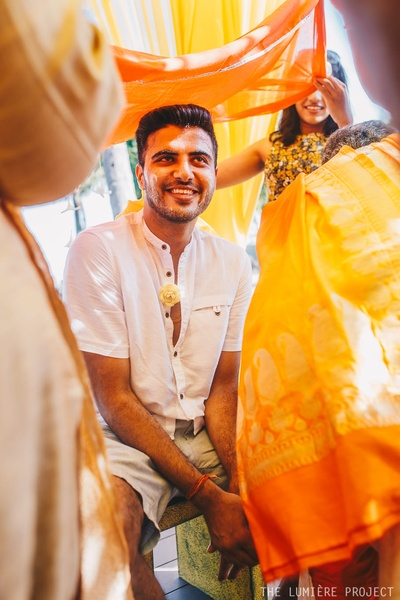 The groom enjoying his haldi ceremony with family and friends!