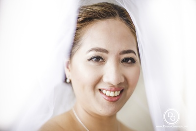 Makeup Artist-  Cecelia Masagka opting for a natural day look for Crystie's wedding day