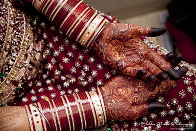 Intricate and detailed bridal mehendi designs adorned with chooda set