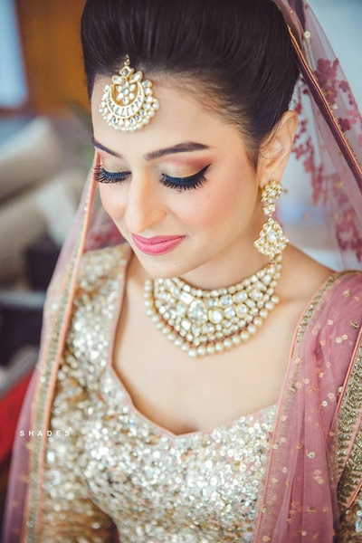 Flawless makeup by Ablaze by Simran Thakkar for the wedding day!