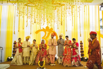 Unique mandap with the floral backdrop and floral pastings