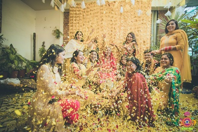 bride with her tribe at her haldi ceremony