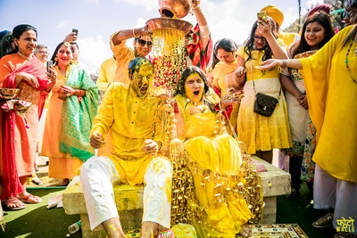 Family and friends having a super-fun and entertaining time at the couple's haldi ceremony!