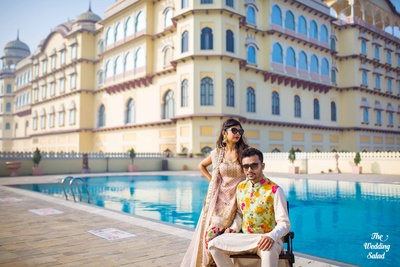 The gorgeous couple strike a pose for their wedding! Love the co-ordinated prints that this couple are wearing!