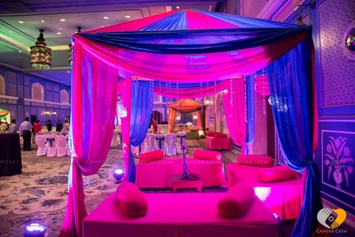 Cabana style decor with pink and blue drapes with bolsters