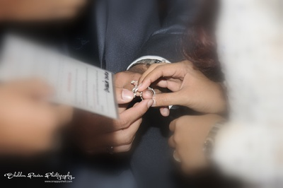Couple exchanging wedding bands