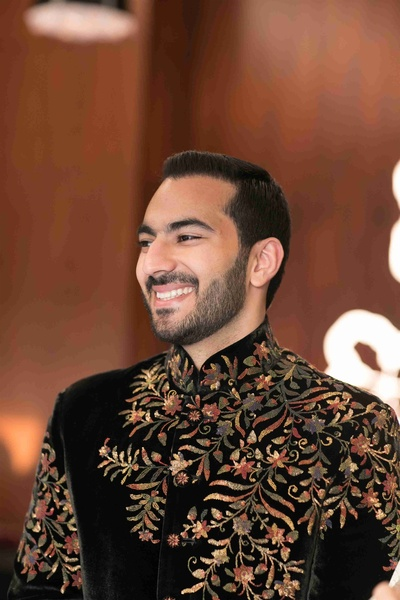 A candid portrait of the groom at his sangeet