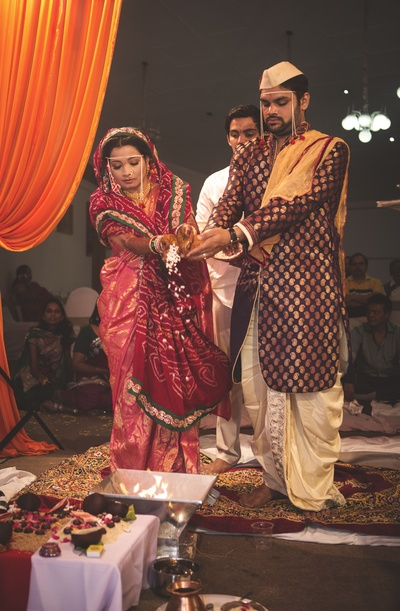 Textured with mango designs Sherwani styled with dhoti