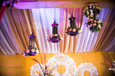 Antique lanterns decorated with clustered floral arrangement