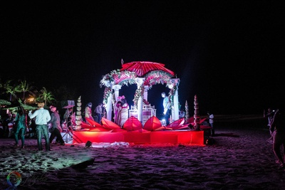 Red lotus like outdoor decor for the beach wedding ceremony