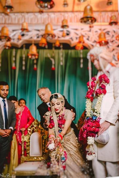 Gorgeous bride following the wedding rice ritual