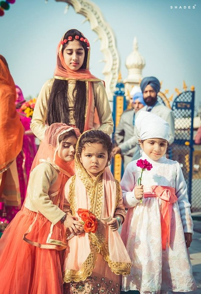 Cute kids wearing Indian outfits at the wedding ceremony.