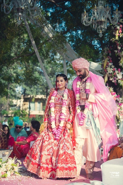 bride and groom in their gorgeous wedding outfits post the wedding ceremony
