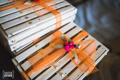 wooden boxes decorated with ribbon for wedding favours