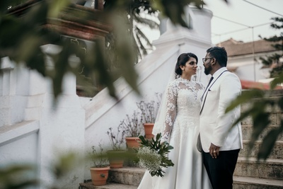 A unique shot of the bride and groom post their church wedding.