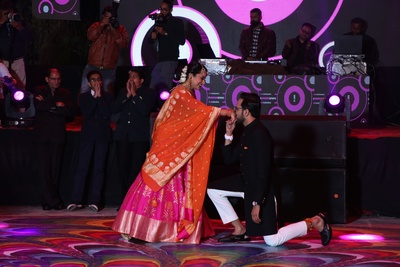 Groom going down on his knees during their sangeet performance