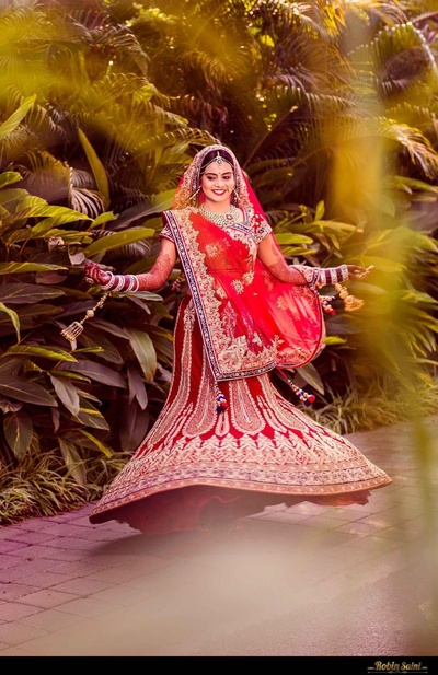 Red A-lined wedding lehenga looks heavenly on the bride