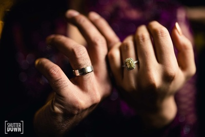 The bride and groom's engagement rings shot by ShutterDown Photography