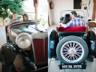Enjoying their pre wedding photo shoot in a vintage red and black classic car