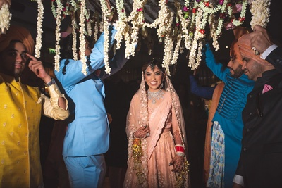 Bridal entry under a phoolon ki chadar