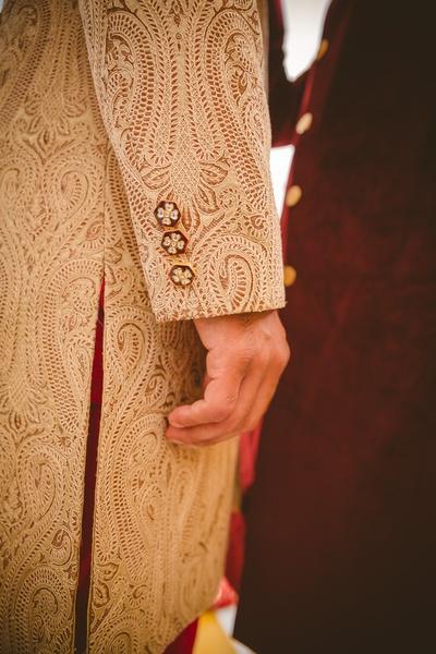 Beige textured Sherwani with meenakari button details