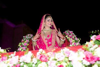 Pink bridal lehenga, styled with polki studded necklace set, raani haar and gold bangle set