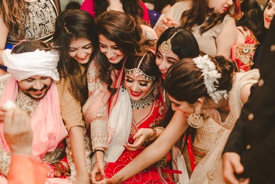 One photo capturing all the fun that goes on between the couple and their bride's girl gang.