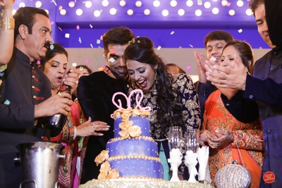 Wedding cake cutting ceremony.