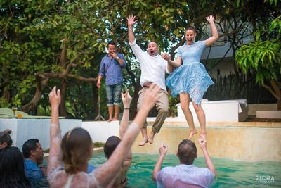Celebrating the wedding, by jumping into a pool, how unique is that?